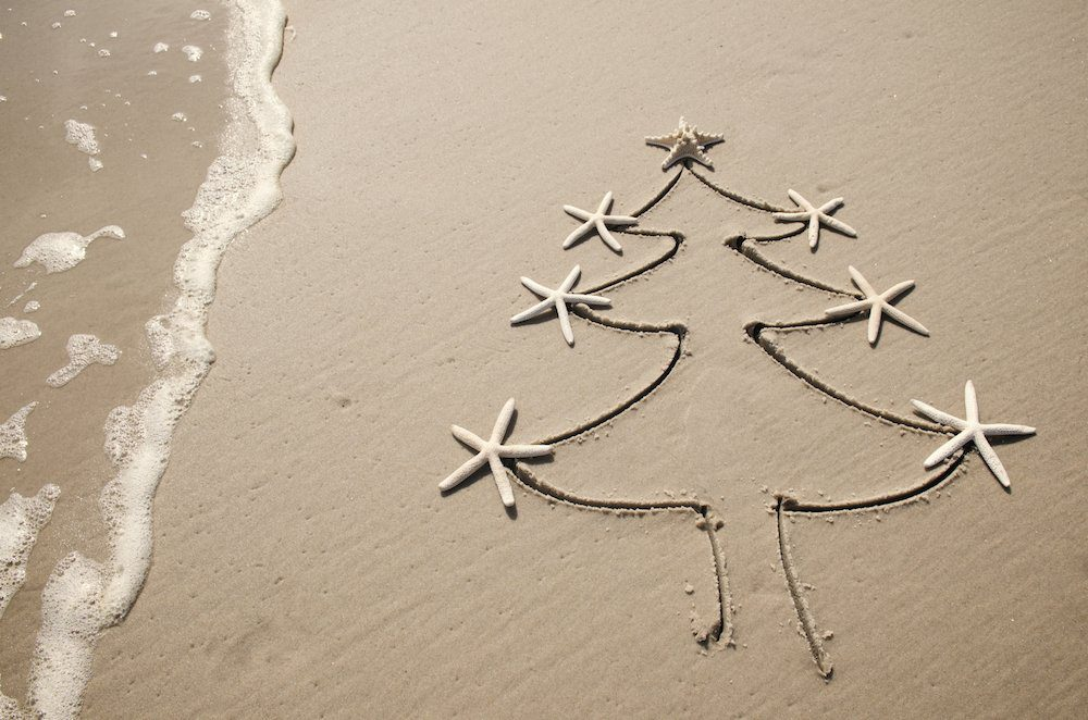 Christmas tree drawn in the sand