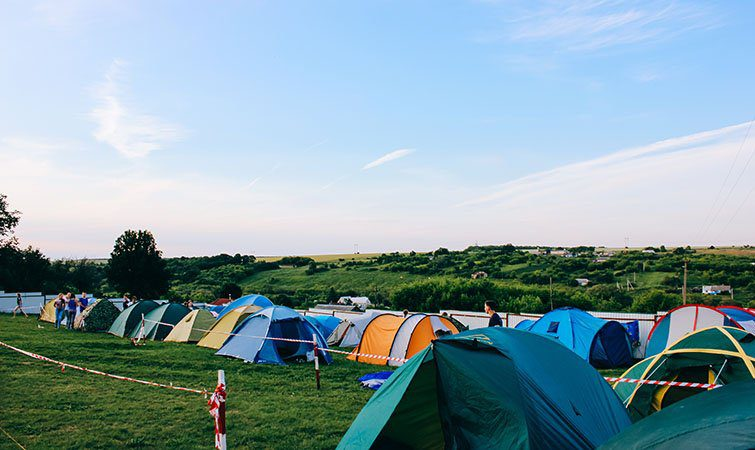 Row of tents at camp grounds